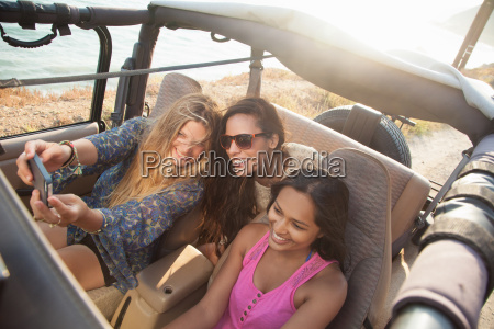 three young women taking selfie on