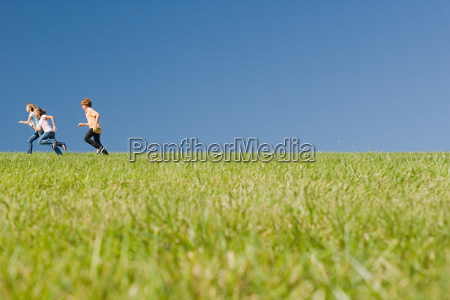 children running in field