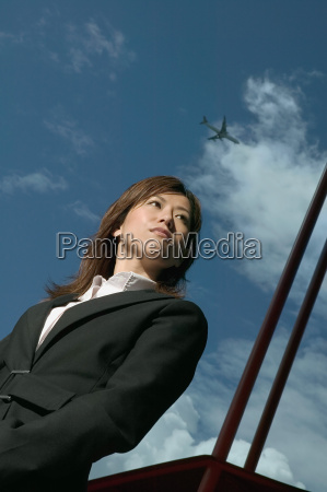 businesswoman and cloudy sky