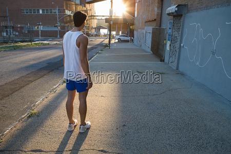 male runner on urban street