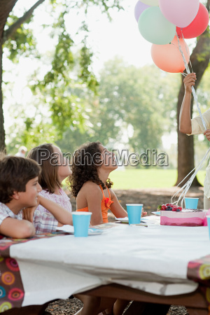 children at birthday party with birthday