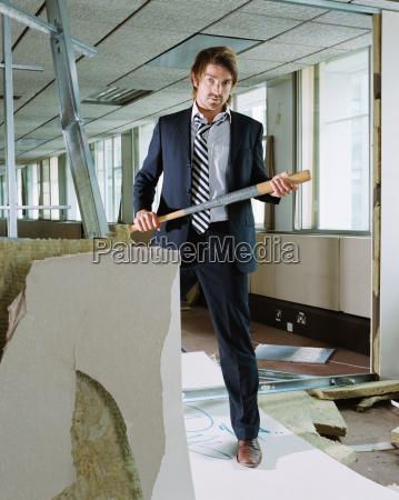 businessman holding baseball bat