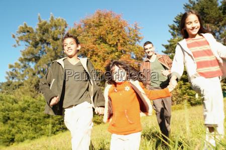 children running in meadow