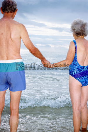 a mature couple holding hands on