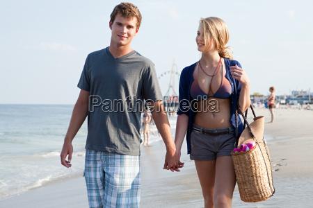 teenage couple walking hand in hand