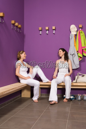 two women talking in changing room