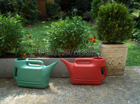 a pair of watering cans in