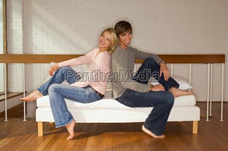 young couple on sofa