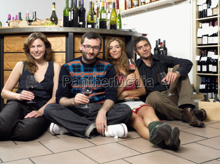 group of friends on floor at