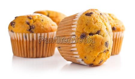 os muffins saborosos com chocolate