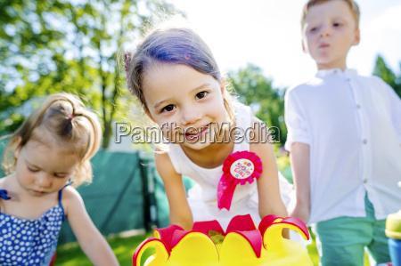 happy little girl having birthday party