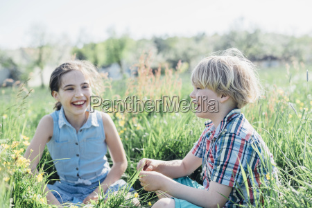 happy boy and girl sitting in