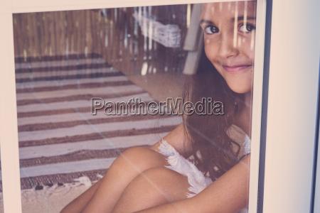 portrait of smiling little girl sitting