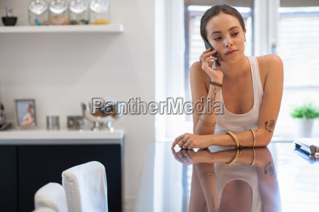 sad looking young woman leaning on