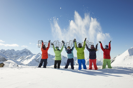 friends throwing snow mid air kuhtai