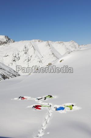 friends making snow angels kuhtai austria
