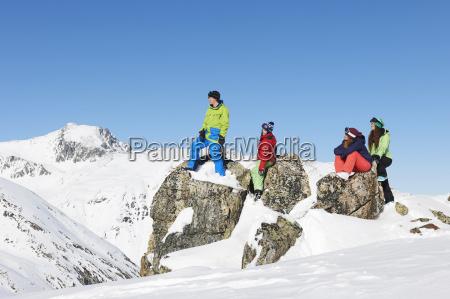 friends on rocks in snow kuhtai