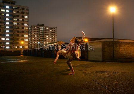 young couple dancing in urban environment