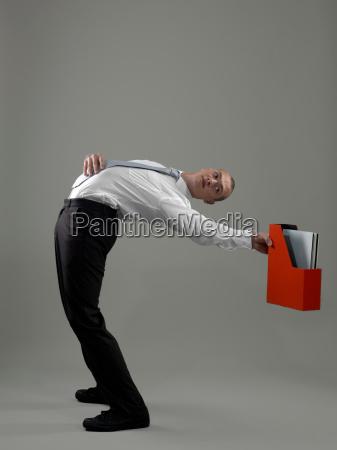 business man holding paper holder