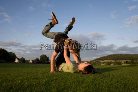 couple playing in field