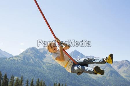 boy playing on swing tyrol austria