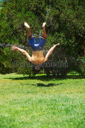 young man upside down in mid