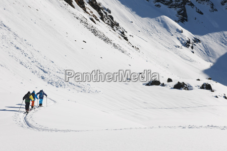 skiers walking through snowy landscape kuhtai