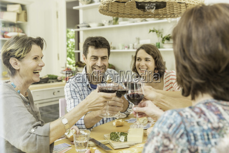 adult friends making a toast with