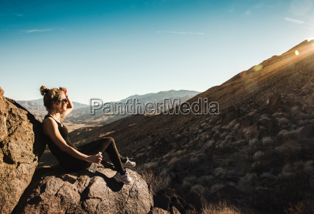 mid adult hiker looking at view