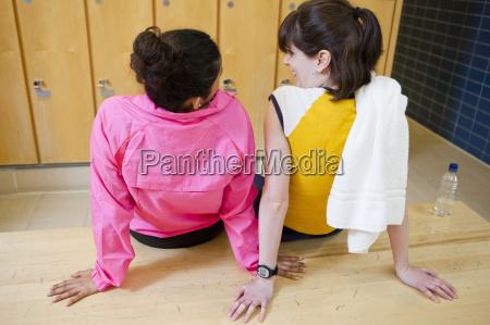 women talking in locker room