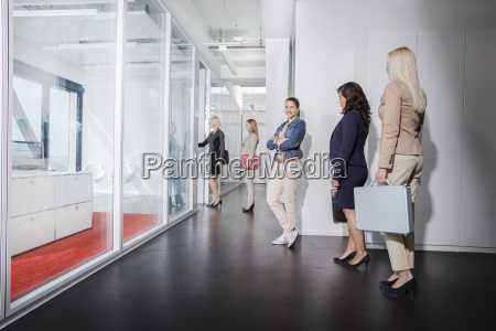 women queueing outside interview room