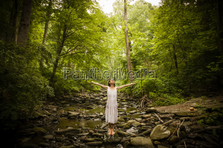 mid adult woman standing barefoot on