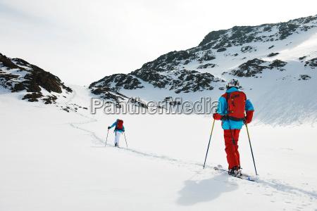 skiers walking in snow kuhtai austria