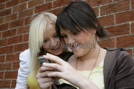 two young women looking at mobile