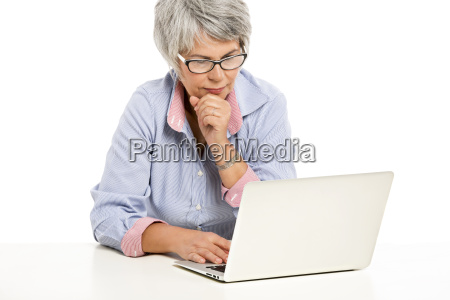 ellderly woman working with a laptop