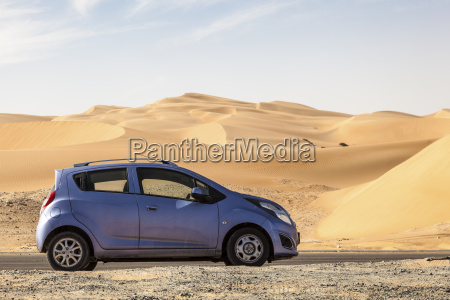 car at the desert road