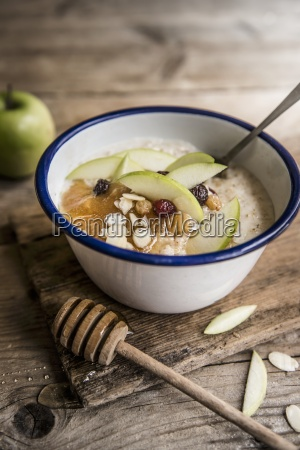 a bowl of porridge with apple
