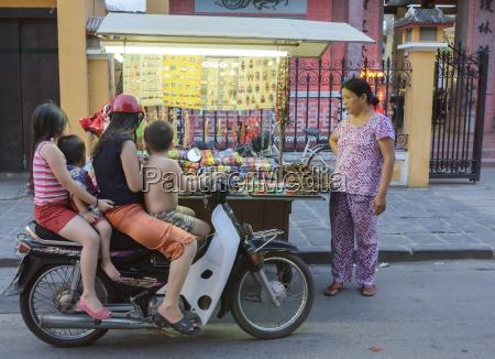 children stop by on their motorbike