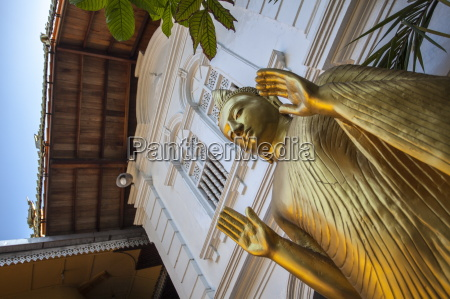 golden statue at the entrance of