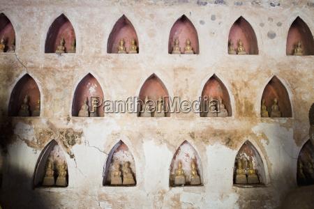 pairs of small buddha statues at
