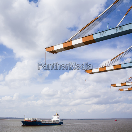 germany bremerhaven container ship passing pier