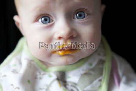 portrait of baby boy against black
