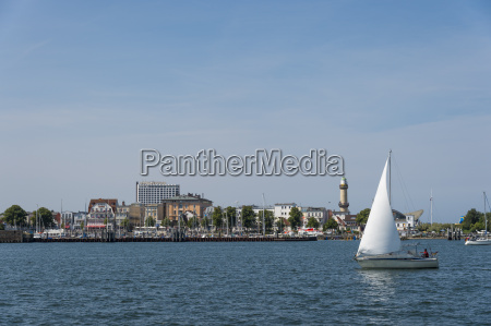 germany warnemuende old lighthouse dinghy sailing