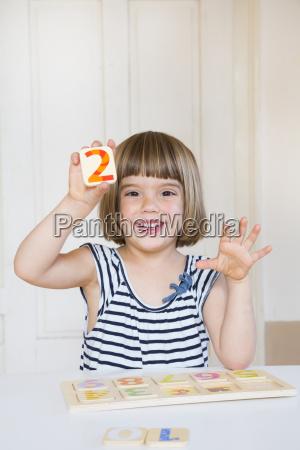 portrait of smiling little girl learning