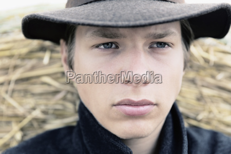 portrait of teenage boy with hat