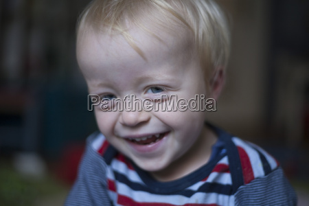 portrait of laughing little boy