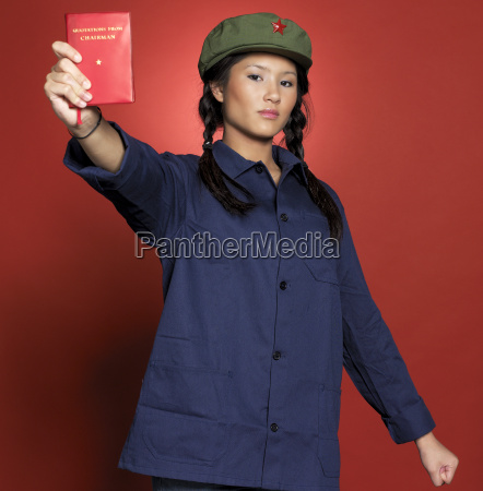 young woman standing with book portrait