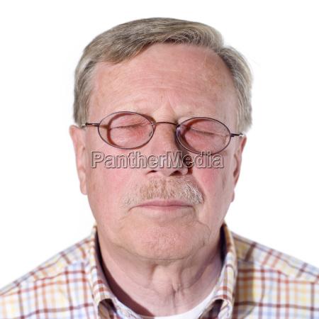 senior man eyes closed portrait