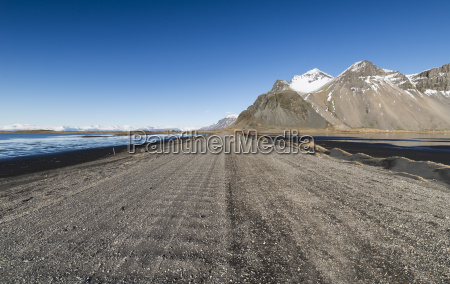 iceland dirt road in vestrahorn and