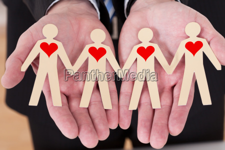 hand showing paper cut out figures